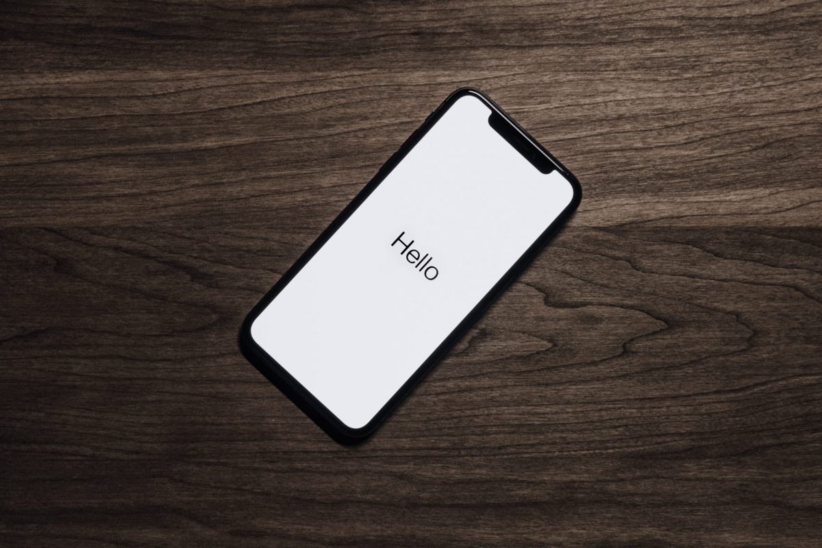 black-iphone-7-on-brown-table-699122