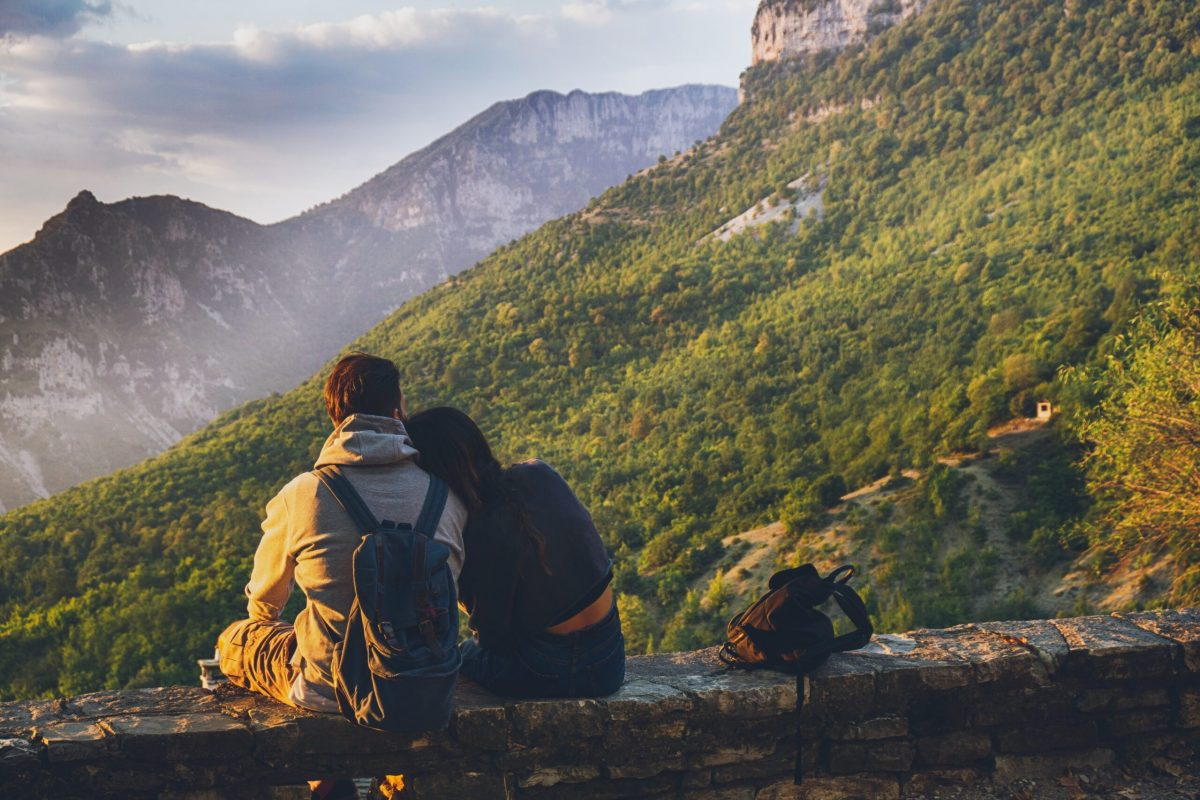 couples-sitting-in-while-facing-mountain-1483024
