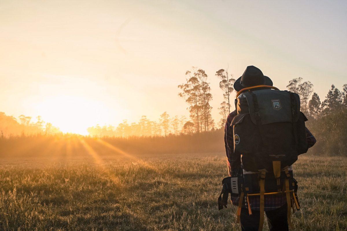 man-in-black-backpack-during-golden-hour-1230302